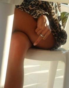 under-table-womans-legs-giving-finger-upskirt